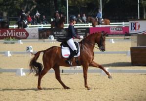 Charlotte Dujardin riding a flying change