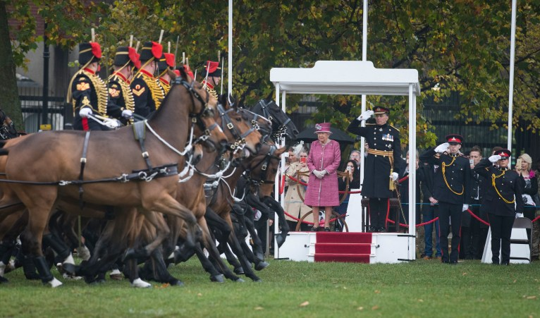 Pictured: Her Majesty The Queen watches the parade. image - Corporal Dek Traylor / MoD Crown