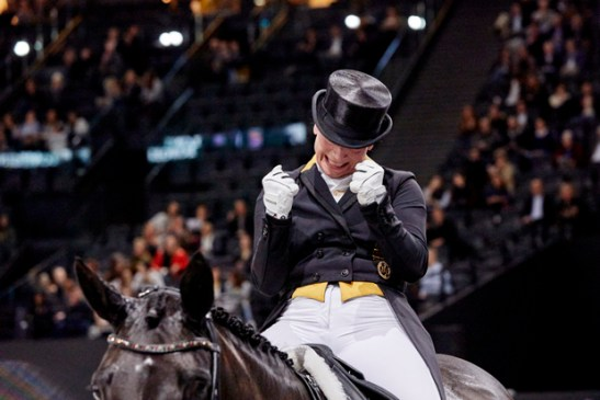 """""""Yes! We've done it again!"""" Germany's Isabell Werth, the most medalled athlete in equestrian sport, celebrates victory with Weihegold at the FEI World Cup™ Dressage Final 2018 in Paris (FRA) today. (FEI/Liz Gregg)"""
