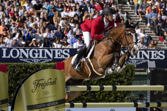 """Niels Bruynseels and Gancia de Muze helped Belgium's """"Never Give Up"""" team to beat them all in the battle for the coveted Longines FEI Jumping Nations Cup™ Trophy 2018. The road to the thrilling 2019 series Final in Barcelona (ESP) begins once again in Wellington (USA) next weekend. (FEI/Lukasz Kowalski)"""
