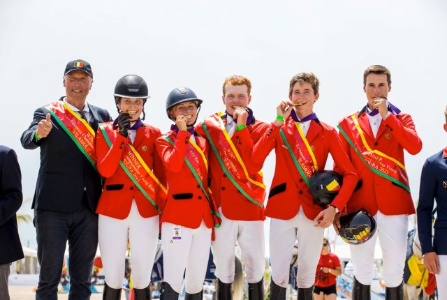 Belgium's Thibeau Spits, Emilie Conter, Maartje Verberckmoes, Alexander Housen and Thibeau Philippaerts with Chef d'Equipe Rik Deraedt on the top step of the Young Riders podium at FEI Jumping European Championships Young Riders, Juniors, Children 2021 in Vilamoura (POR). (FEI/Leanjo De Koster)
