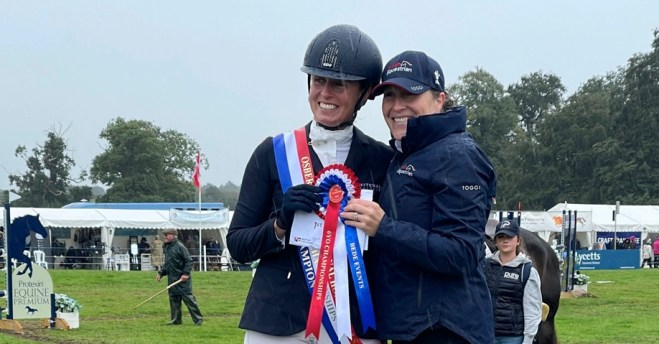 Jodie Amos receives her prize from BE Helen West