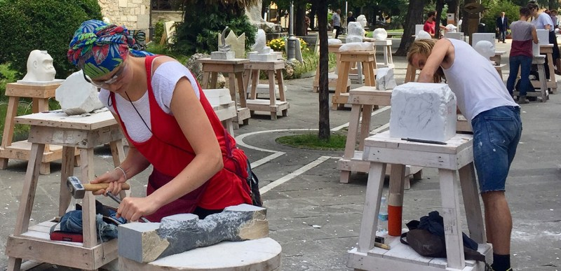 White Carrara Downtown - En Plein Air hand-sculpture lessons with the Carrara Academy of fine Arts students