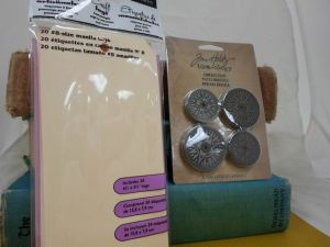20 manilla tags and Tim's Holtz idea-ology compass coins