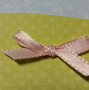 Glue dot on the back of the bow