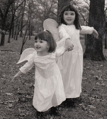 Black and white photo of two young girls dressed as angels