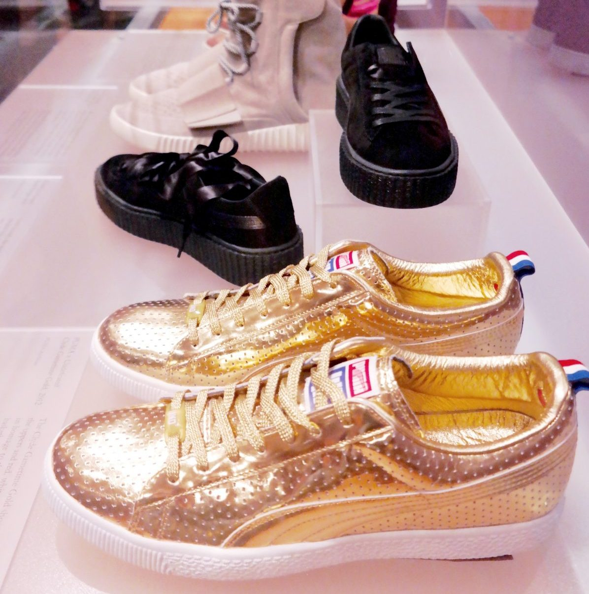 pair of gold sneakers