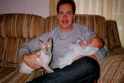 Bailey, Dad, and newborn me.