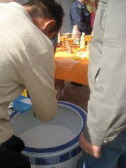 Milk to be offered at the dedication of Erdenet's new Buddha statue.