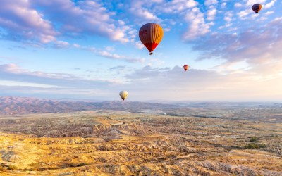 CAPPADOCIA – Flying a hot air balloon into the sunrise
