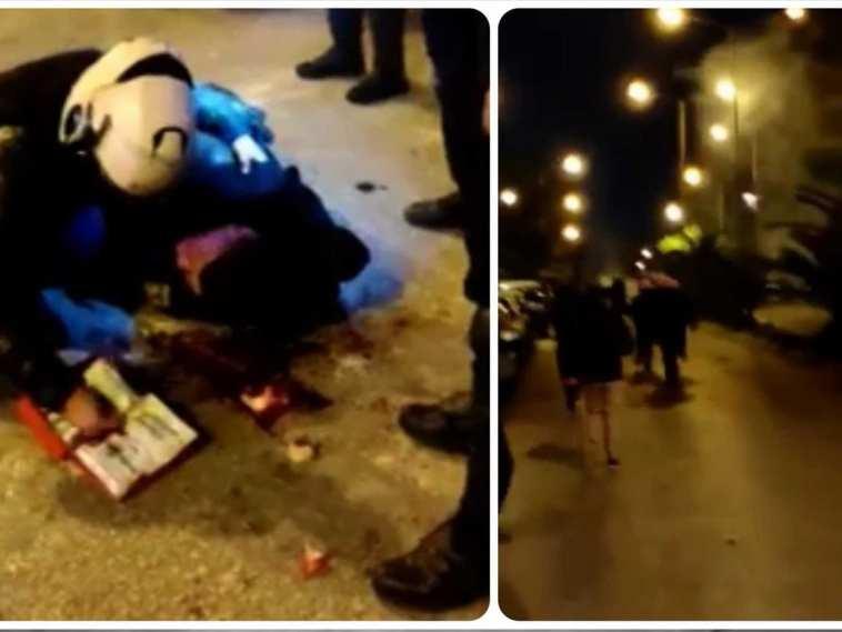Είναι η στιγμή που ο τραυματίας αστυνομικός είναι ξαπλωμένος στον δρόμο