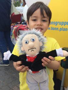 little boy plays with Beethoven doll, Bonn Fest der Kulturen