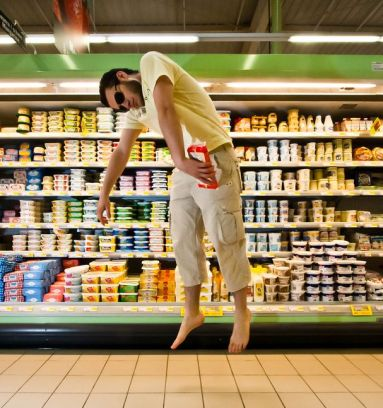 Shopping man floating in supermarket
