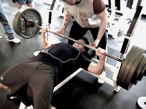 Man on bench, pressing barbell