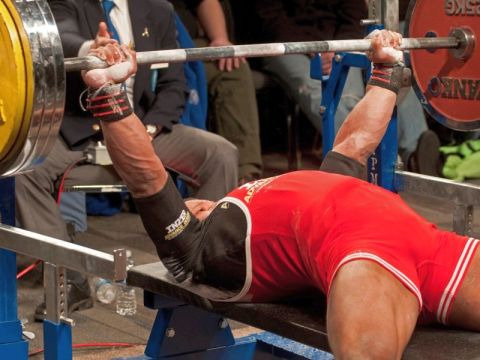 Man doing the bench press exercise.