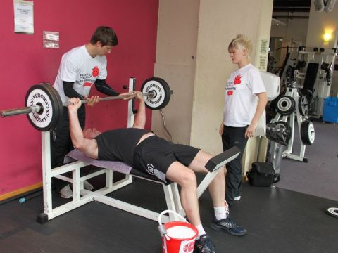 People doing the bench press exercise.