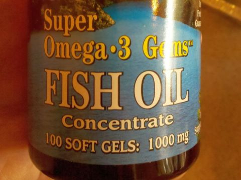 Bottle of fish oil capsules