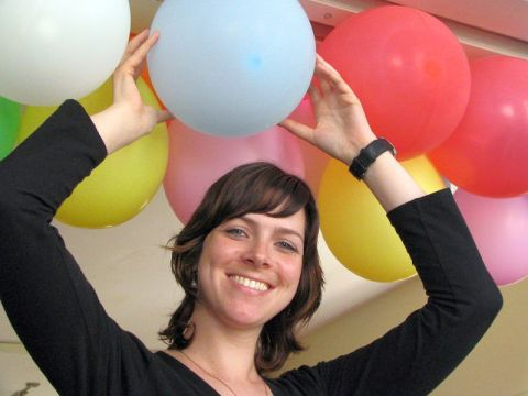Smiling woman holding ballon
