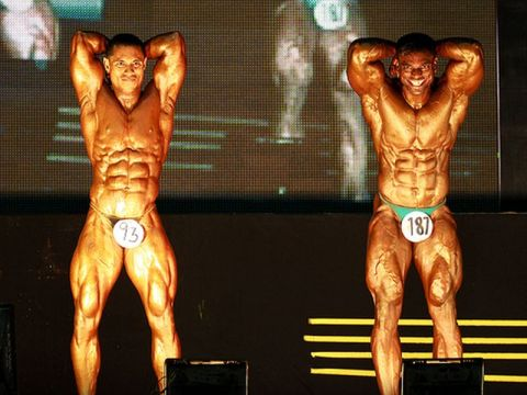 Bodybuilders posing at contest.
