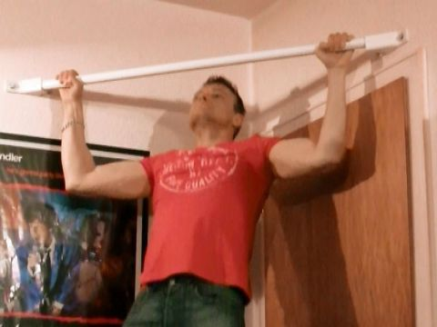 man doing wide pull-ups