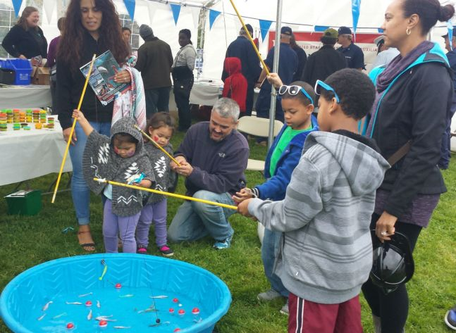 City of Emeryville Community Services gave away sunglasses, playdough and flower seeds to young fishers.