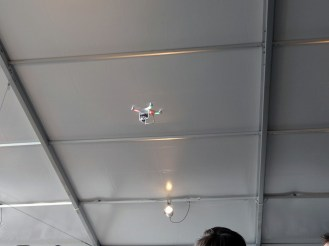 Yes that's a drone with a camera flying around the tent.