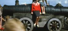 Girls climbing on cannon
