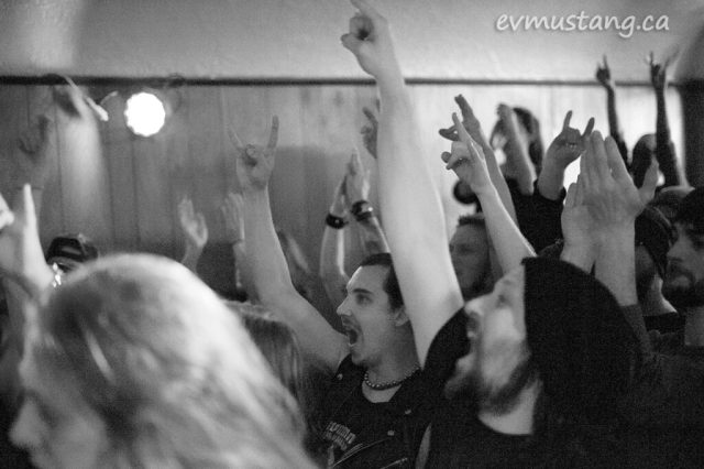 image of crowd at mokomokai show with their devil horn hands raised
