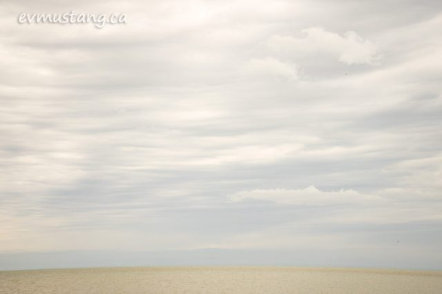 image of port burwell beach looking out over the water wich reflects the diffuse light