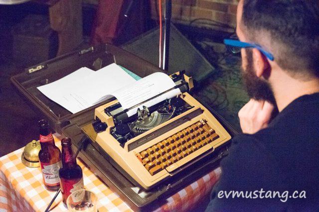 image of justin million sitting at corona typewriter