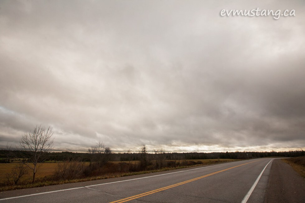 image of dark november sky over two lane county road