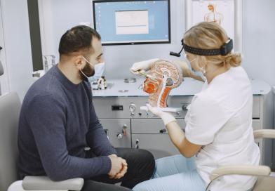 Otolaryngologist preparing for the medical examination procedure