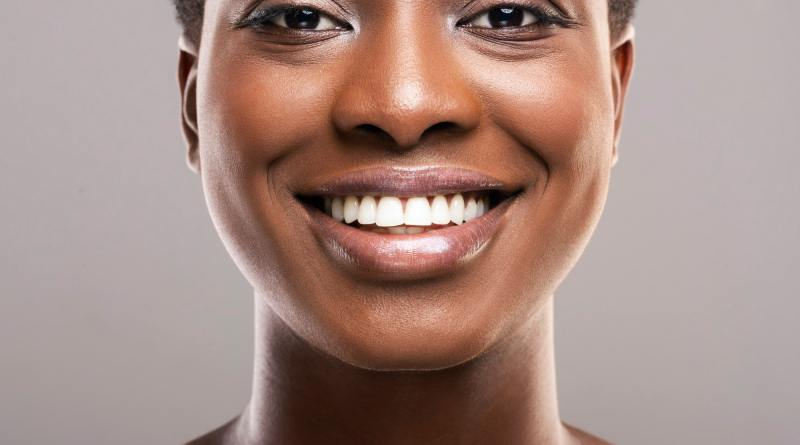 Portrait of black woman with perfect skin and white teeth