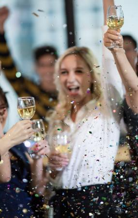 Young business people have fun at a New Year's party 2020