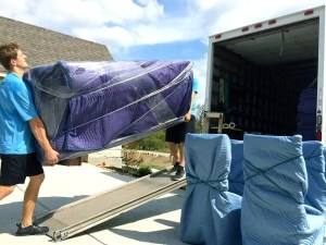 movers loading furniture onto a truck