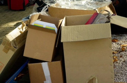 Several open boxes with different items inside still not ready to be moved