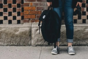 a schooler carrying a backpack