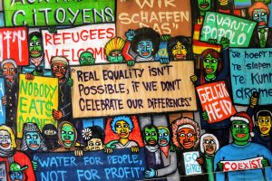 illustration of people holding signs with messages about justice