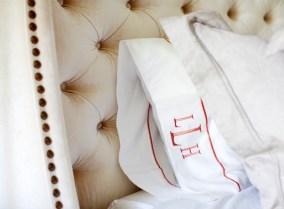 Master bedroom, custom headboard, monogramed bedding