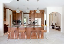 Kitchen, cherry cabinetry, Cambria countertops, pendant lighting