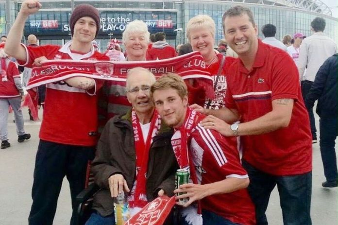 Middlesborough fan David Brown (bottom right) pictured with his family at Wembley (Photo: Gazette live)