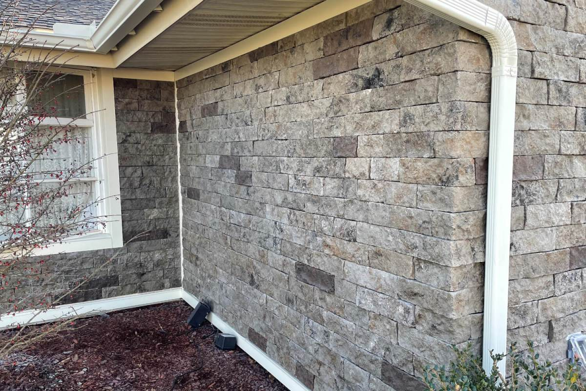 color throughout stone veneer in earthy tones on exterior of house