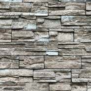 tan and grey mortarless stone veneer that is dry stacked in multiple different sizes and width stones creating textured appearance