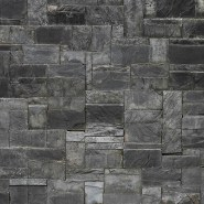 various shade of grey dry stacked mortarless stone veneer all the same width with different heights and lengths