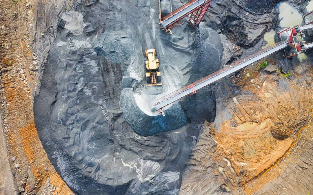 Machines mining raw materials.