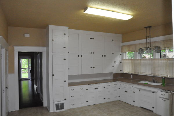 Large kitchen with lots of cupboards before downsizing into an RV to travel the country.