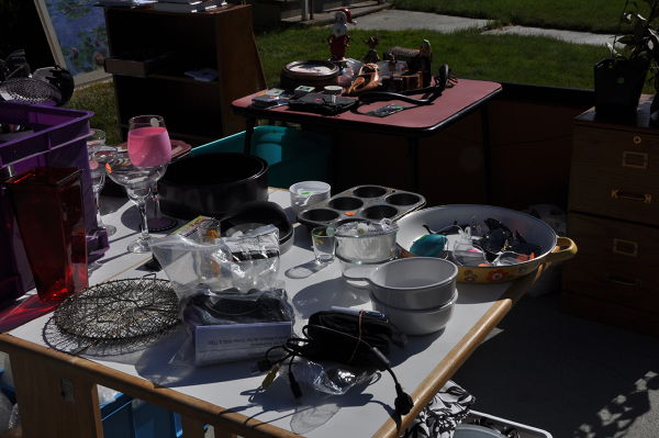 Many yard sale items on tables being sold before starting our RV Adventure.
