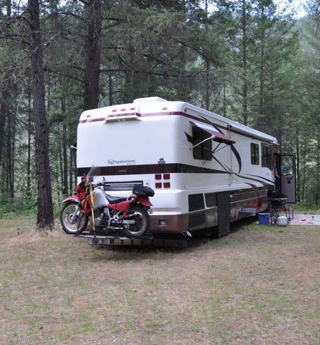 KLR Motorcycle mounted on the bike carrier on the back of the RV while living full time in the RV.