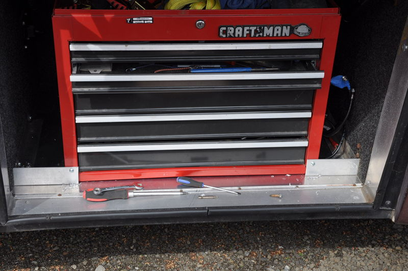 Toolbox with new mounts in lower RV bay before hitting the road full time in our RV.