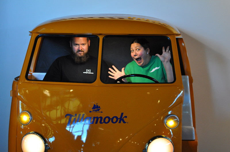 We are sitting in the Tillamook Creamery photo prop van making funny faces on our full time RV living adventure.